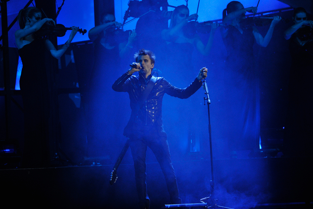 Description of . Matthew Bellamy of Muse performs on stage during the Brit Awards 2013 at the 02 Arena on February 20, 2013 in London, England.  (Photo by Matt Kent/Getty Images)