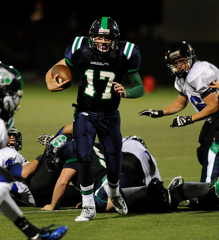 . HIGHLANDS RANCH, CO. - SEPTEMBER 13: Grizzlies\' quarterback Brody Westmoreland (17) hurdled lineman on a third quarter pickup. The ThunderRidge High School football team defeated Grandview 21-7 at Shea Stadium Friday night, September 13, 2013.  Photo By Karl Gehring/The Denver Post