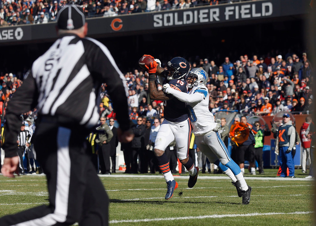 . Chicago Bears wide receiver Brandon Marshall (15) makes a touchdown reception against Detroit Lions cornerback Darius Slay during the first half of an NFL football game on Sunday, Nov. 10, 2013, in Chicago. (AP Photo/Charles Rex Arbogast)