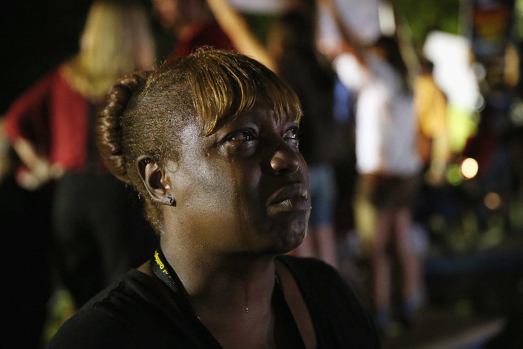 . SANFORD, FL - JULY 13: Tanetta Foster breaks into tears in front of the Seminole County Criminal Justice Center after learning George Zimmerman had been found not guilty in the Murder of Trayvon Martin on July 13, 2013 in Sanford, Florida. Zimmerman, a neighborhood watch volunteer shot and killed 17-year-old Martin after an altercation in February 2012.  (Photo by Scott Olson/Getty Images)
