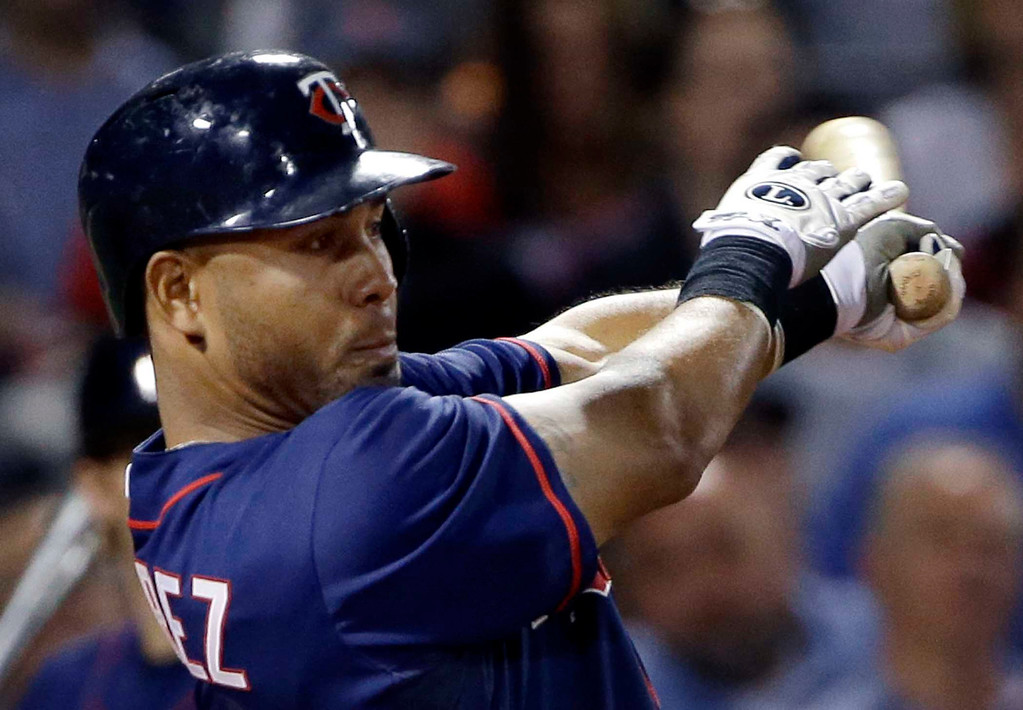 . Minnesota Twins\' Wilkin Ramirez hits an RBI single against the Boston Red Sox during the fifth inning of a baseball game at Fenway Park in Boston, Tuesday, May 7, 2013. (AP Photo/Elise Amendola)