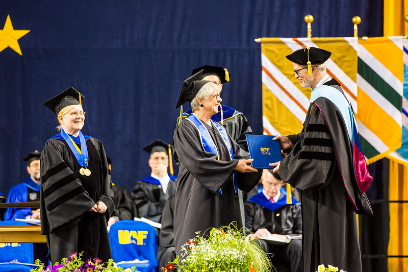 Althea St. Martin receives the Meritorious Service Award during UAF's 2018 commencement ceremony at the Carlson Center on May 5, 2018.