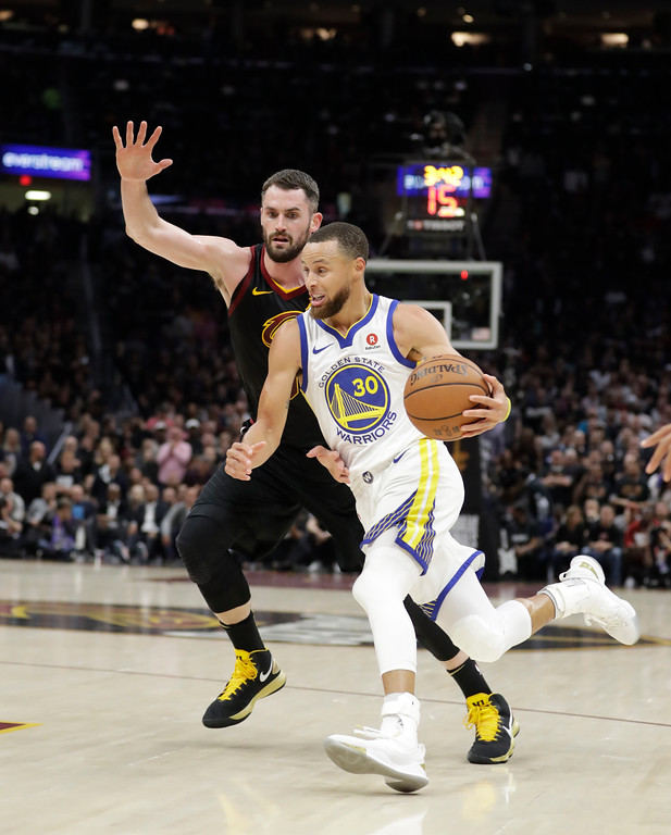 . Golden State Warriors\' Stephen Curry goes to the basket against Cleveland Cavaliers\' Kevin Love during the first half of Game 3 of basketball\'s NBA Finals, Wednesday, June 6, 2018, in Cleveland. (AP Photo/Tony Dejak)
