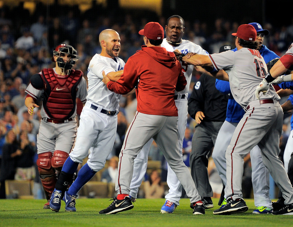 . A scuffle breaks out after Los Angeles Dodgers starting pitcher Zack Greinke was hit by a pitch during the seventh  inning of their baseball game against the Arizona Diamondbacks, Tuesday, June 11, 2013, in Los Angeles.  (AP Photo/Mark J. Terrill)