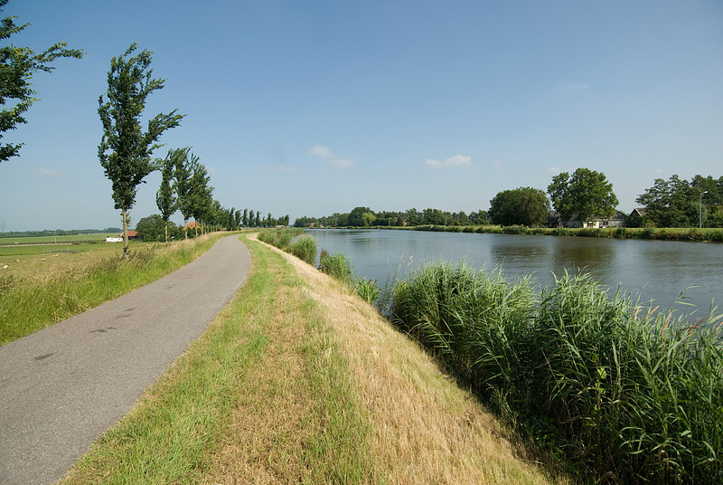 Road alongside the river in Beemster Polder, Netherlands