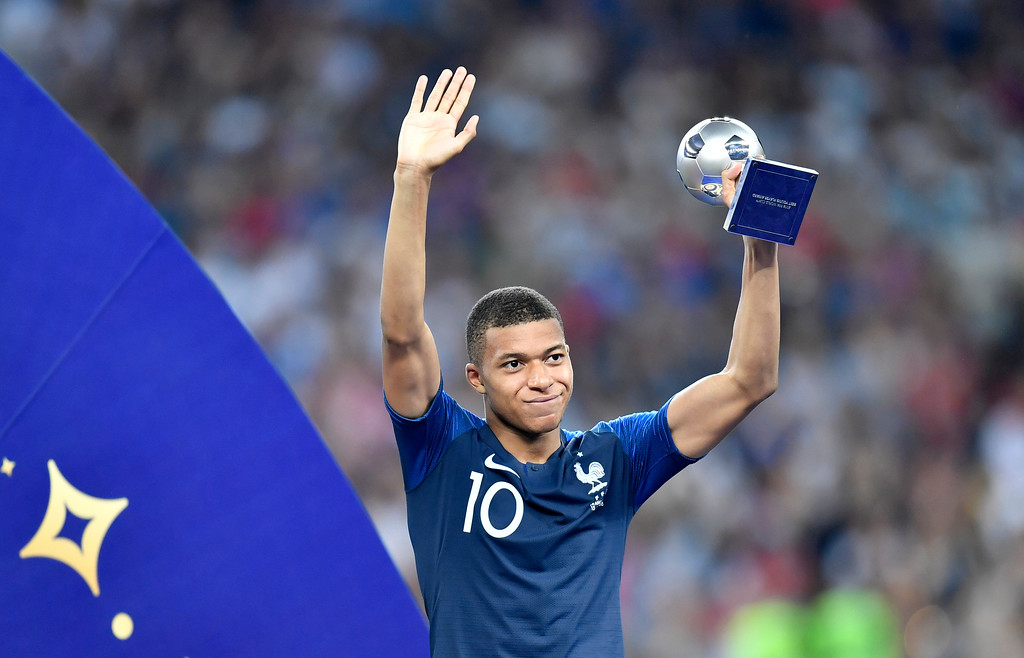 . France\'s Kylian Mbappe poses with the best young player award after the final match between France and Croatia at the 2018 soccer World Cup in the Luzhniki Stadium in Moscow, Russia, Sunday, July 15, 2018. (AP Photo/Martin Meissner)