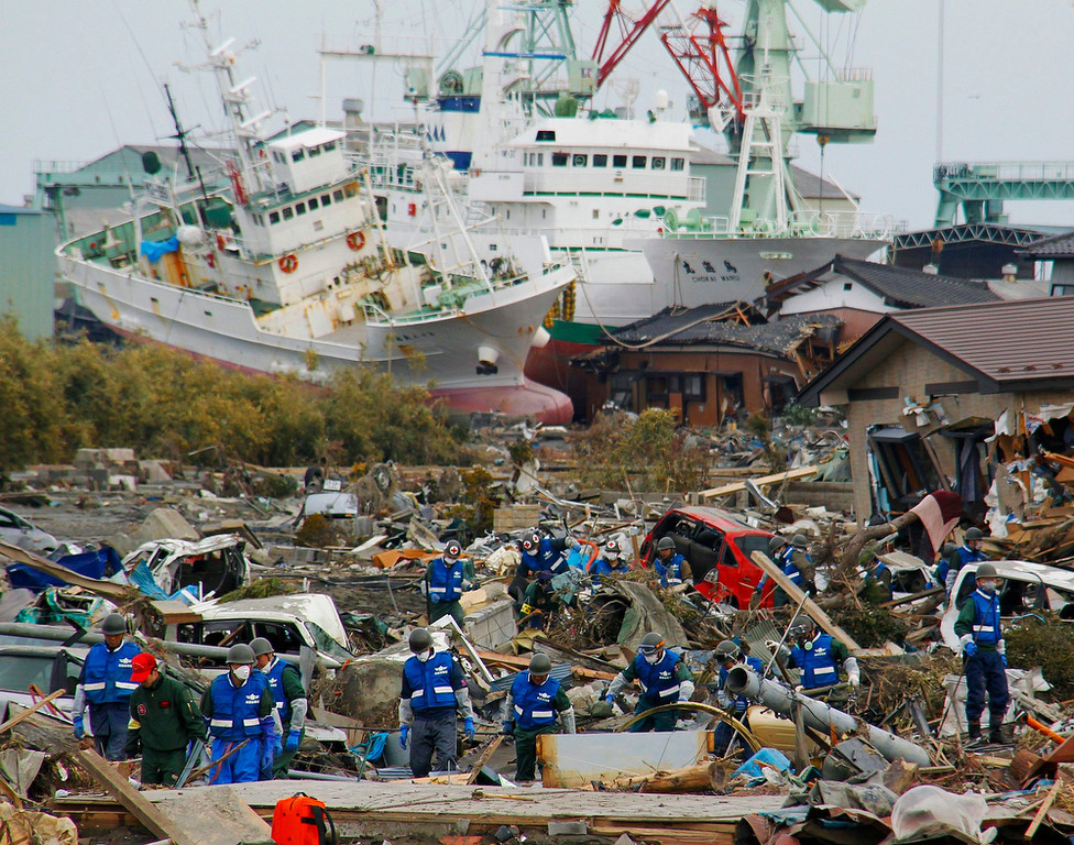 . Soldiers of Japan Self-Defense Force and firefighters search for the victims in the rubbles Monday, March 14, 2011 in Matsushima, Miyagi Prefecture, Japan, three days after northeastern coastal towns were devastated by an earthquake and tsunami. (AP Photo/Kyodo News)
