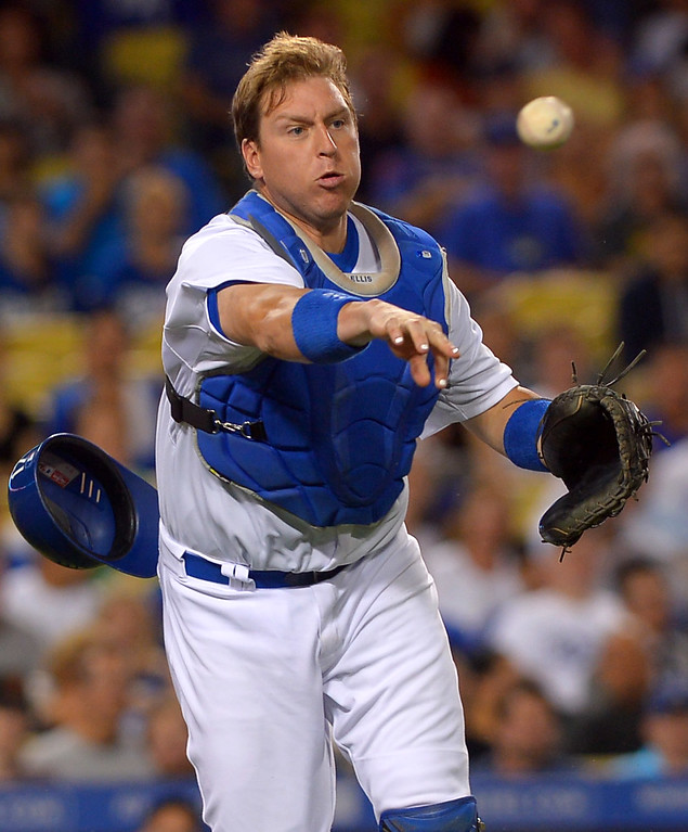 . Los Angeles Dodgers A.J. Ellis throws out a Cubs batter August 26, 2013 in Los Angeles, CA.(Andy Holzman/Los Angeles Daily News)