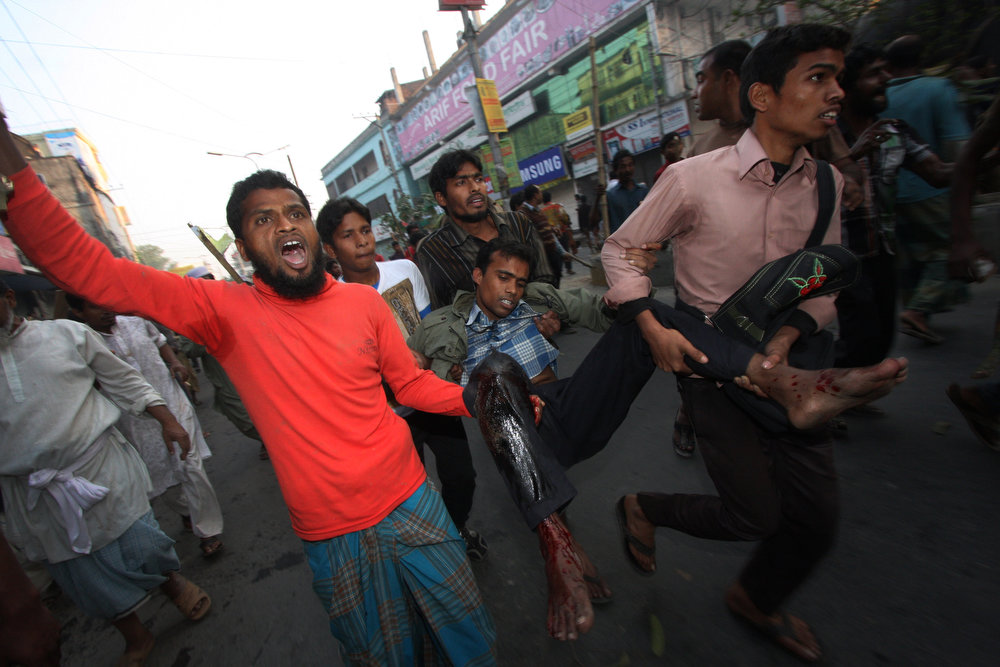 . Bangladeshi Islamist activists carry a wounded protester after he was injured during clashes with police in Bogura some 120kms north of Dhaka on March 3, 2013. Bangladesh deployed troops in the north of the country after 16 more people were killed in a fresh wave of violence over the conviction of Islamist leaders for war crimes in the Muslim-majority nation.  STRDEL/AFP/Getty Images
