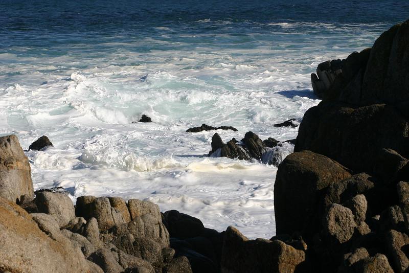 Ocean crashes against the rocks.