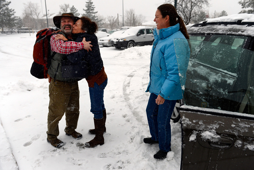 . LITTLETON, CO. - MARCH 23: (l-r) Scott Kool, of Sioux, IA, is greeted by his sisters, Lisa Lammers and Staci Hanson, as he arrives at the  RTD station in downtown Littleton, CO March 23, 2013. The family is gathering to celebrate Staci\'s birthday next week. The Saturday forecast calls for snow accumulation of 9 to 12 inches with highs in the lower to mid 20s. (Photo By Craig F. Walker/The Denver Post)