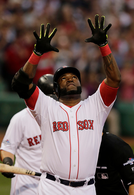. Boston Red Sox designated hitter David Ortiz celebrates his solo home run off Tampa Bay Rays starting pitcher David Price in the first inning in Game 2 of baseball\'s American League division series Saturday, Oct. 5, 2013, in Boston.  (AP Photo/Charles Krupa)
