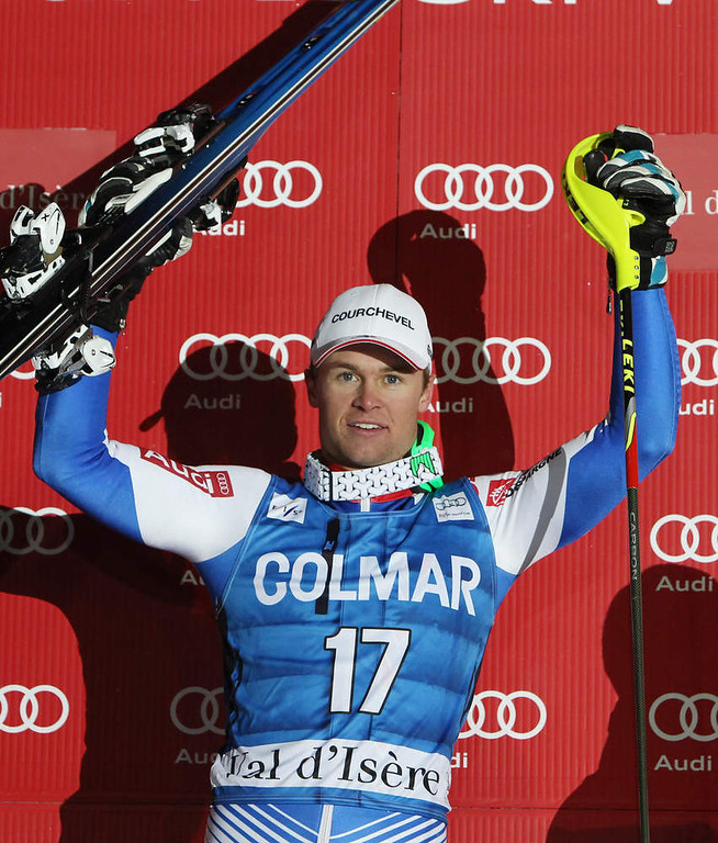 . France\'s Alexis Pinturault celebrates on podium after winning an alpine ski, men\'s World Cup slalom in Val d\'Isere, France, Saturday, Dec. 8, 2012. (AP Photo/Alessandro Trovati)
