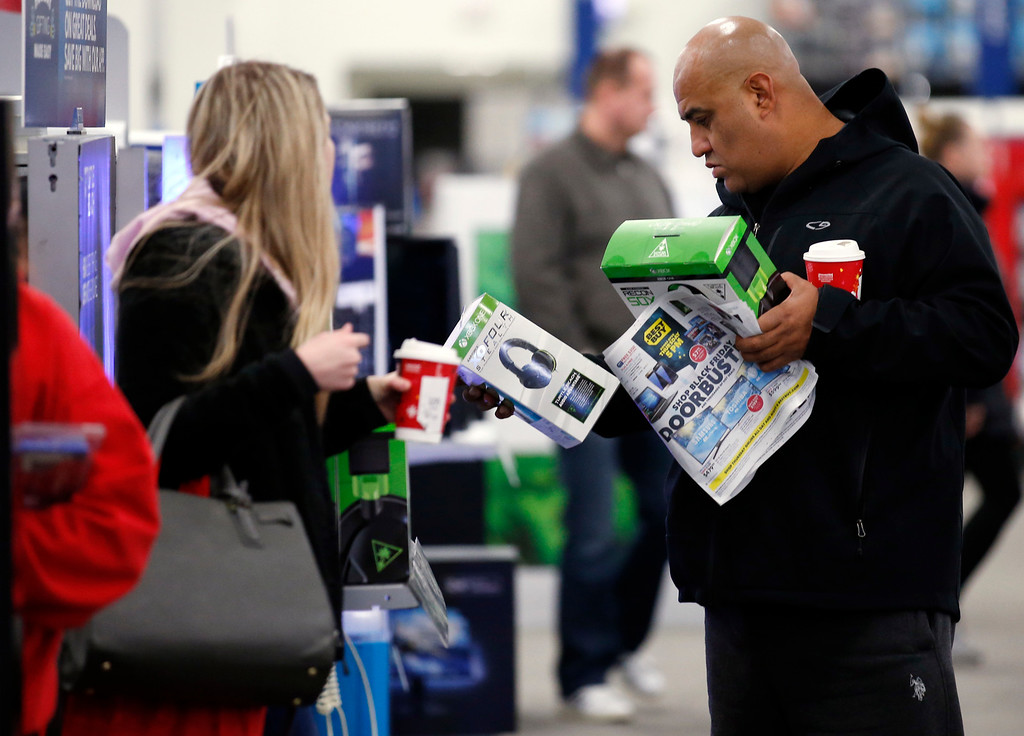 . Shoppers browse items at a Best Buy store on Friday, Nov. 25, 2016, in Skokie, Ill. Black Friday, historically the starting line of the retail industry\'s crucial holiday buying season, isn\'t quite the one-day spree it used to be. Some retailers have pushed their biggest Black Friday door-buster deals into Thanksgiving Day and spread other promotions to even earlier in the season. (AP Photo/Nam Y. Huh)