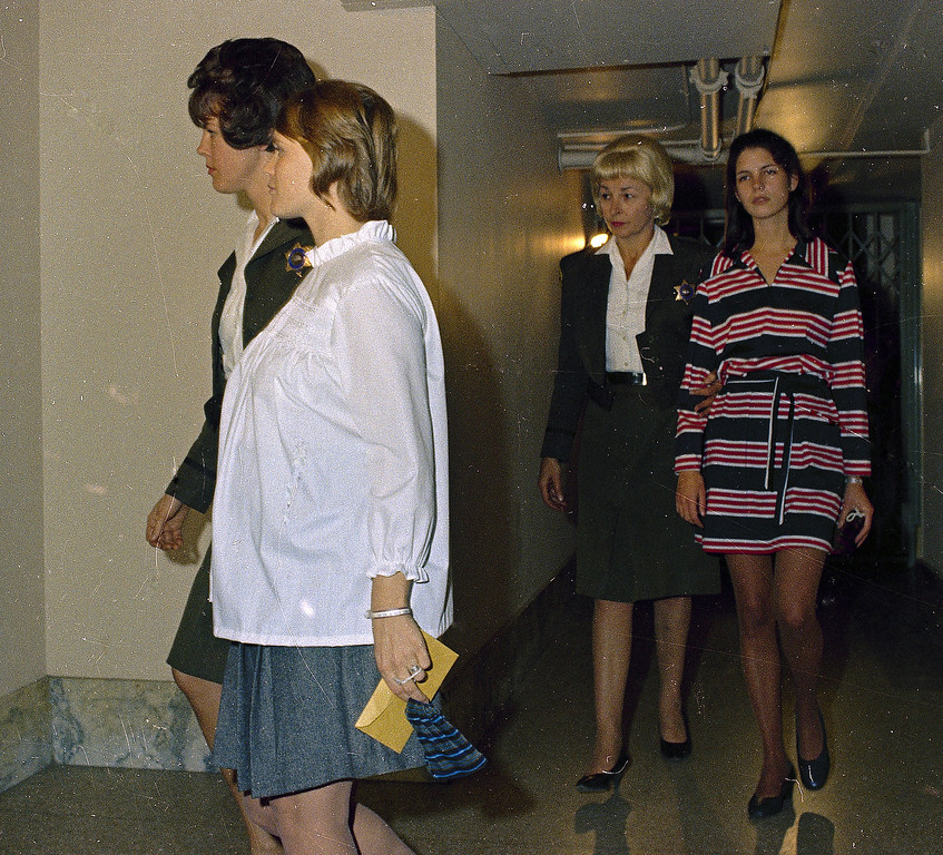 . Linda Kasabian, left, and Leslie Van Houten, in striped dress, involved in the Tate-LaBianca murder case are seen in 1969.  (AP Photo)