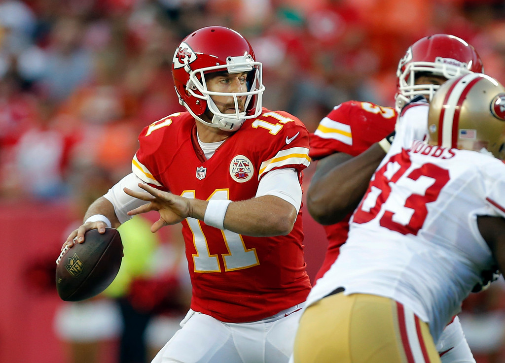 . Kansas City Chiefs quarterback Alex Smith (11) passes to a teammate during the first half of an preseason NFL football game against the San Francisco 49ers at Arrowhead Stadium in Kansas City, Mo., Friday, Aug. 16, 2013. (AP Photo/Ed Zurga)