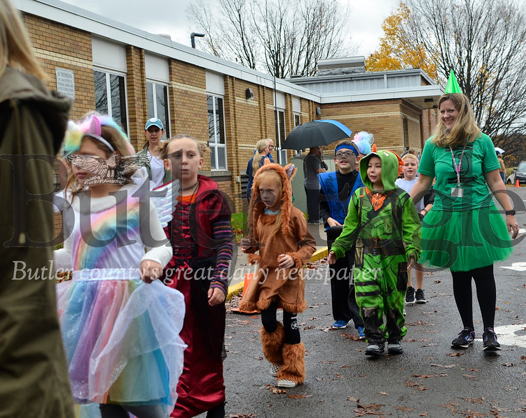 Connoquenessing Elementary students parade through their school's parking lot on Oct. 31, 2019. Tanner Cole/Butler Eagle