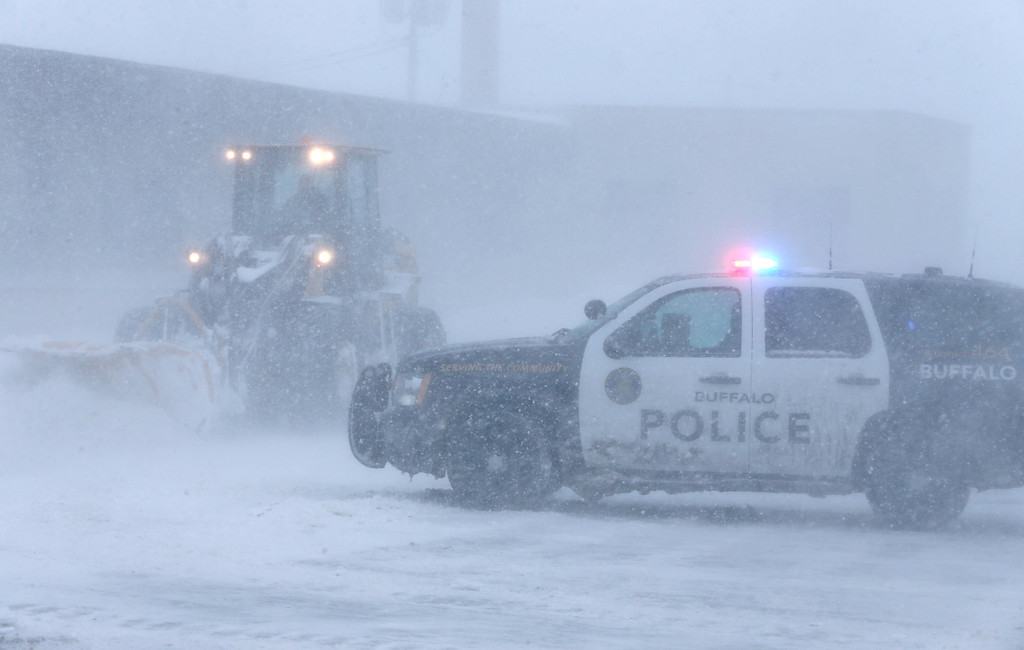 . Buffalo Police block traffic on Bailey Avenue at the intersection with Clinton Street as heavy equipment clears snow, Tuesday, Nov. 18, 2014.    (AP Photo/The Buffalo News, Derek Gee)
