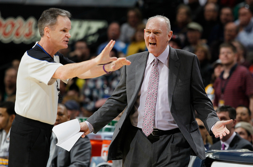 . Denver Nuggets coach George Karl, right, argues a call with referee Mike Callahan in the fourth quarter of the Nuggets\' 97-90 victory over the Boston Celtics in an NBA basketball game in Denver on Tuesday, Feb. 19, 2013. (AP Photo/David Zalubowski)