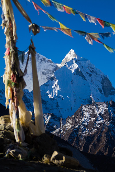 Prayer Flags Fly Above Kangtega, A Summit In The Himalayas, Nepal