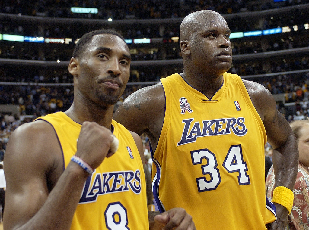 . Los Angeles Lakers\' Kobe Bryant, left, and Shaquille O\'Neal celebrate after winning Game 5 of the Western Conference semifinals against the San Antonio Spurs, 93-87, Tuesday, May 14, 2002, in Los Angeles. The Lakers advance to the Western Conference Finals against the Sacarmento Kings.  (AP Photo/Mark J. Terrill)