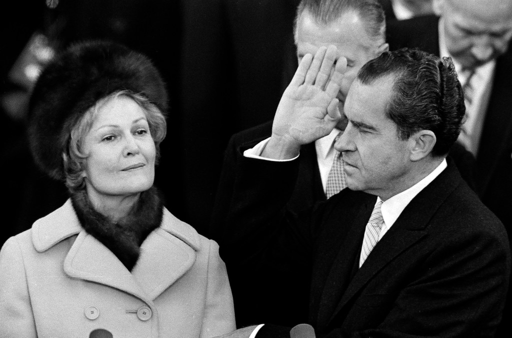 . Richard Nixon holds his left hand on two family bibles and raises his right as he takes the oath as 37th President of the United States on the Capitol steps in Washington, D.C., Jan. 20, 1969. Behind his right hand is Vice President Spiro Agnew. Mrs. Pat Nixon holds the bibles. (AP Photo)
