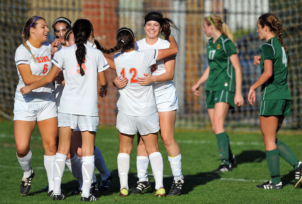 . LAKEWOOD - 02/14/2013  (Photo: Scott Varley, Los Angeles Newspaper Group)  St. Joseph hosts La Reina (Thousand Oaks) in a first-round Division 3 girls soccer playoff game. St. Joseph won 4-0. Teammates congratulate St. Joseph\'s Sarah Haley, right in white, after her 1st half goal.