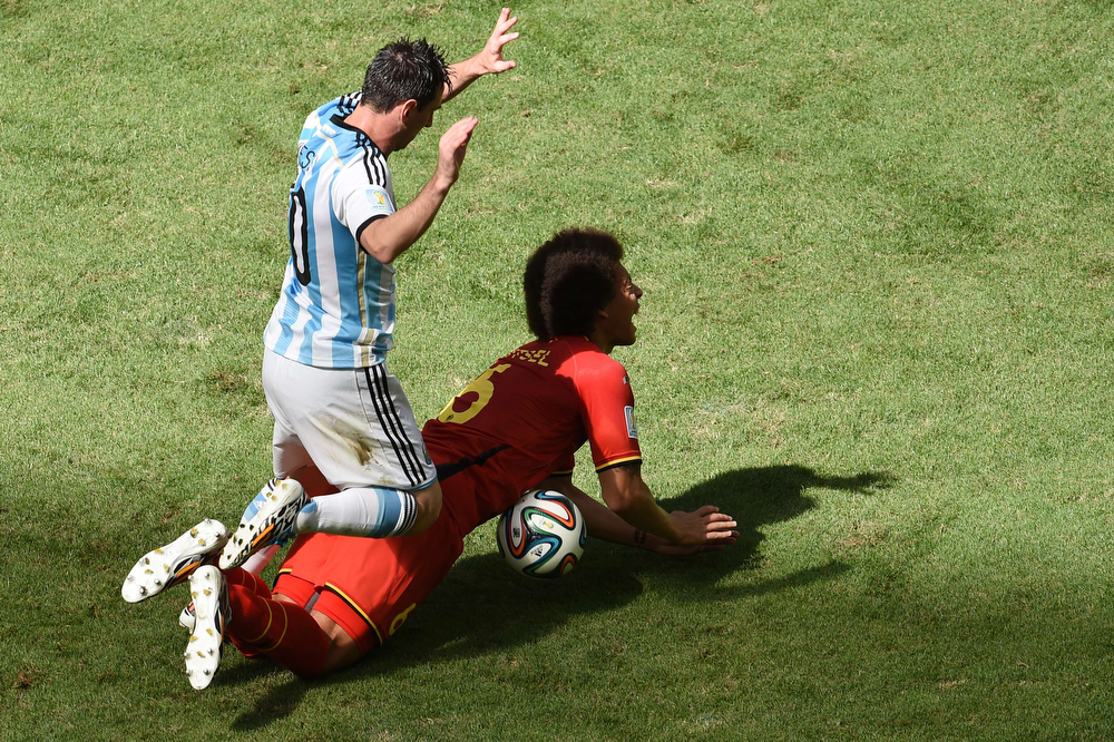 . Argentina\'s forward and captain Lionel Messi (L) vies with Belgium\'s midfielder Axel Witsel during a quarter-final football match between Argentina and Belgium at the Mane Garrincha National Stadium in Brasilia during the 2014 FIFA World Cup on July 5, 2014. (EVARISTO SA/AFP/Getty Images)