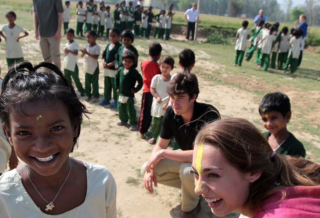 . Mount Madonna School senior Aimee Hopkins, of Corralitos, shares a joyful moment with a young girl at Pardada Pardadi School in Anupshahr, India on March 26.