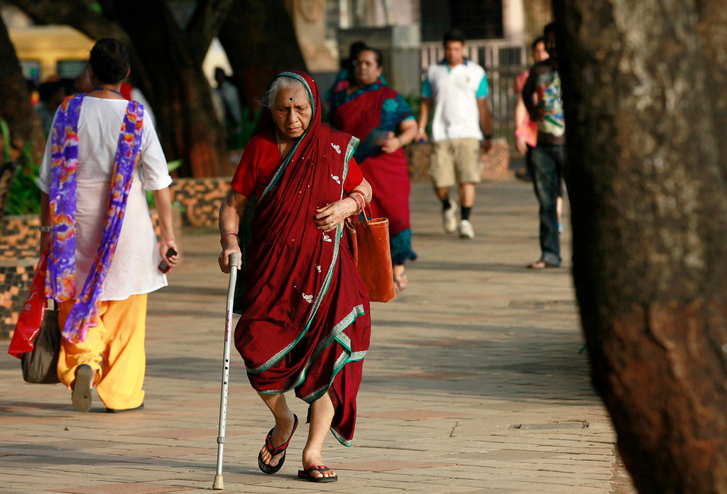 . An elderly Indian woman walks at a park on International Day of Older Persons in Mumbai, India,Tuesday, Oct. 1, 2013. Much of the world is not prepared to support the ballooning population of elderly people, including many of the fastest-aging countries, according to a global study scheduled to be released Tuesday, Oct. 1, by the United Nations and an elder rights group. (AP Photo/Rajanish Kakade)