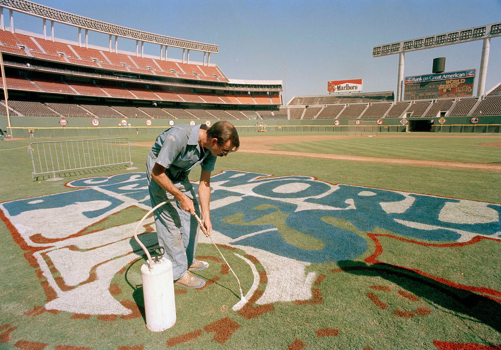 . A groundskeeper at Jack Murphy Stadium paints the logo for the 1984 World Series between San Diego Padres and Detroit Tigers in San Diego October 1984. (AP Photo)