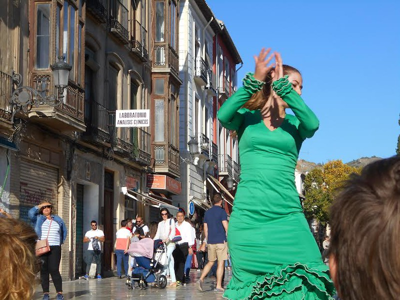 Woman in green dances the flamenco in Granada, Spain