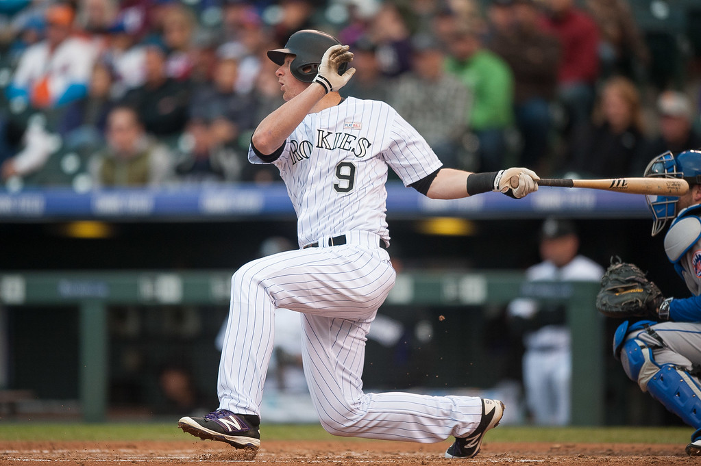 . DJ LeMahieu #9 of the Colorado Rockies hist a second inning RBI single against the New York Mets   at Coors Field on May 14, 2016 in Denver, Colorado.  (Photo by Dustin Bradford/Getty Images)
