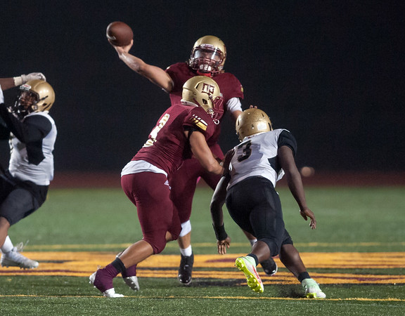 11/02/18 Wesley Bunnell   Staff New Britain football vs East Hartford at Veterans Stadium on Friday night. Tahje Yopp (4) receives protection from Shawn Robinson (3) on a pass play.