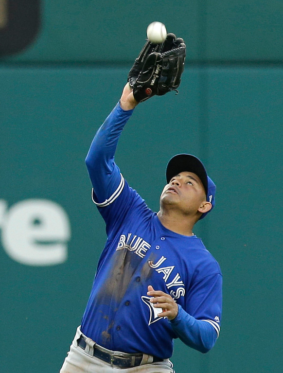 . Toronto Blue Jays\' Ezequiel Carrera catches a fly ball hit by Cleveland Indians\' Francisco Lindor during the third inning of a baseball game, Friday, July 21, 2017, in Cleveland. (AP Photo/Tony Dejak)