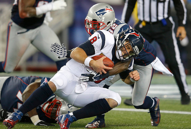 . Houston Texans quarterback Matt Schaub is stopped on a run by New England Patriots\' Devin McCourty in the fourth quarter in their NFL AFC Divisional playoff football game in Foxborough, Massachusetts January 13, 2013.   REUTERS/Brian Snyder