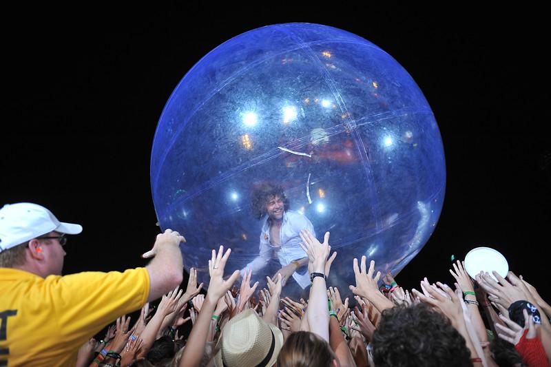 Flaming Lips frontman, Wayne Coyne, rolls around the crowd inside this huge ball.
