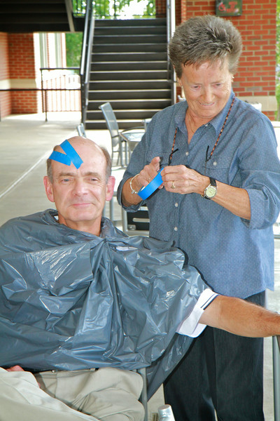 Dr. Frank Bonner gets his hair colored red and black as faculty and staff participate in an ice cream social to celebrate meeting our fall 2014 enrollment goals.