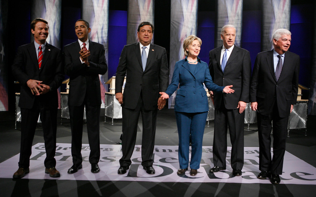 . From left to right, Democratic presidential hopefuls former Sen. John Edwards, Sen. Barack Obama, New Mexico Gov. Bill Richardson, Sen. Hillary Clinton, Sen. Joseph Biden, and Sen. Christopher Dodd, are seen before the Des Moines Register Democratic Presidential Debate in Johnston, Iowa, Thursday, Dec.13, 2007. (AP Photo/Charlie Neibergall)