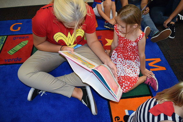 Upper School Super Heroes Read to Lower School Students