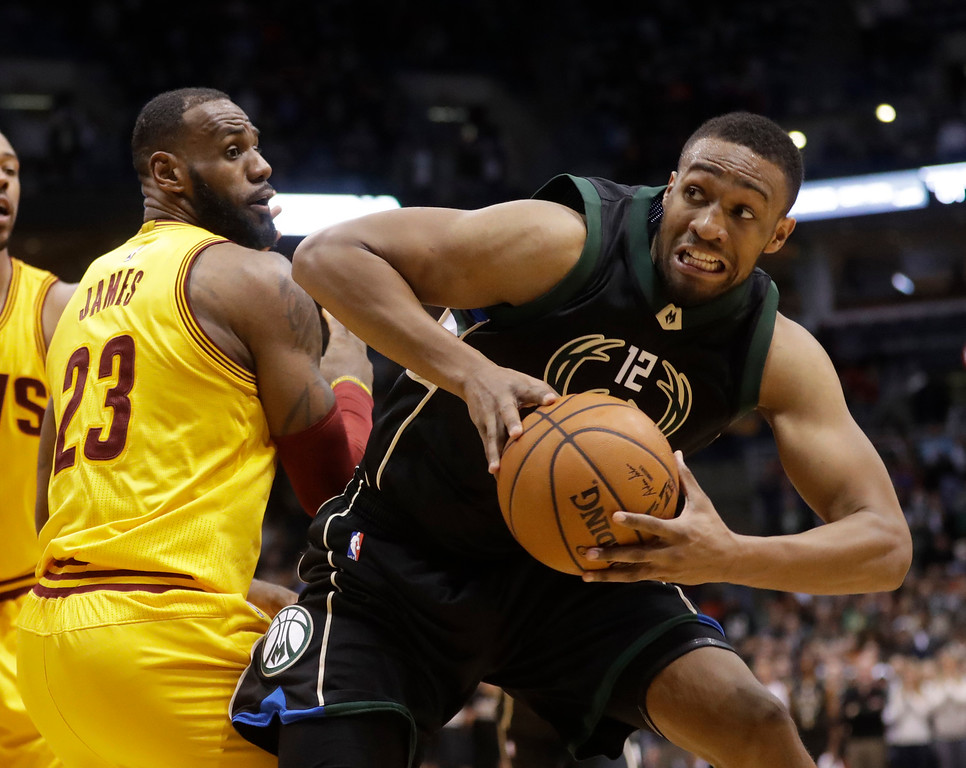 . Milwaukee Bucks\' Jabari Parker tries to shoot past Cleveland Cavaliers\' LeBron James during the second half of an NBA basketball game Tuesday, Dec. 20, 2016, in Milwaukee. The Cavaliers won 114-108. (AP Photo/Morry Gash)