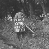 NJ910907B, Man marking Ordnance Survey minor control revision point with an arrow in 1950s