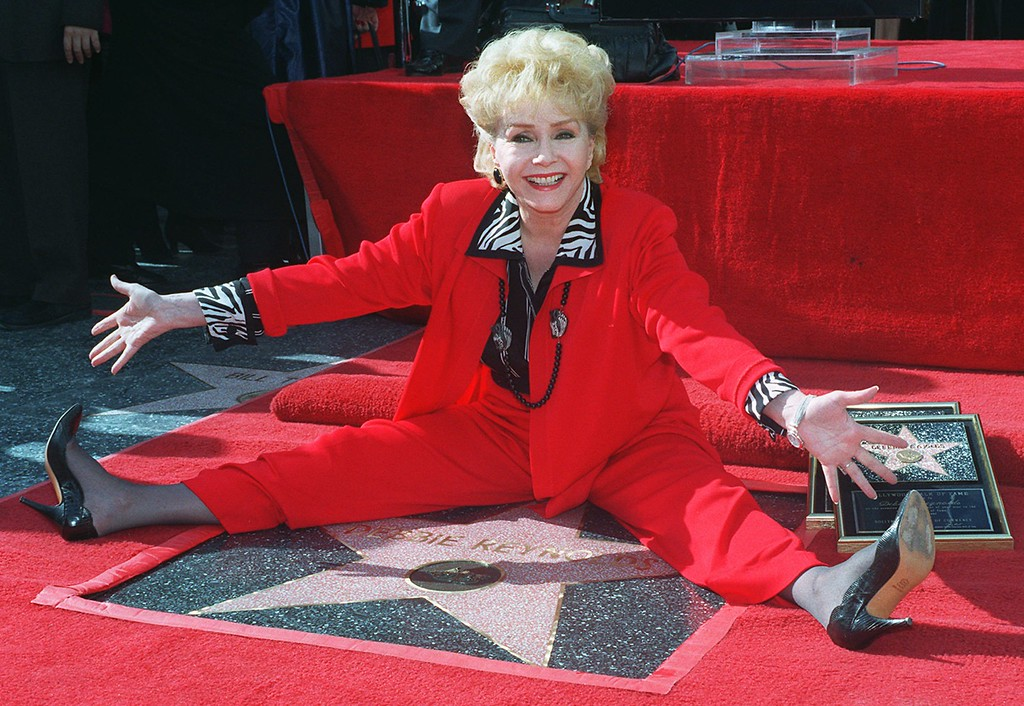 """. Veteran stage and film actress Debbie Reynolds poses with her second star on the Hollywood Walk of Fame, Monday, Jan. 13, 1997, in the Hollywood section of Los Angeles. Reynolds\' latest film is \""""Mother,\"""" which opens nationwide this month. (AP Photo/Chris Pizzello)"""