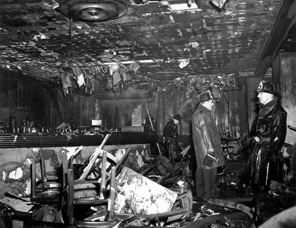 . Firemen inspect the ruins of the Cocoanut Grove Night Club in Boston, Mass., on Nov. 28, 1942. A fire swept through the establishment at night, killing 492 persons. (AP Photo)