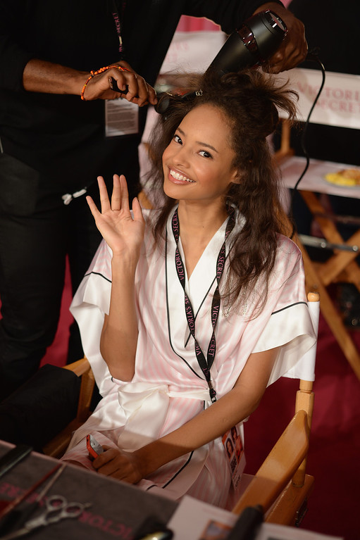 . Model Malaika Firth prepares at the 2013 Victoria\'s Secret Fashion Show hair and make-up room at Lexington Avenue Armory on November 13, 2013 in New York City.  (Photo by Dimitrios Kambouris/Getty Images for Victoria\'s Secret)