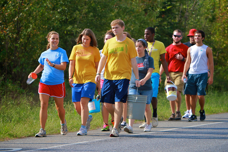 """Students participate in """"Walk a Mile in Their Shoes"""" to raise awareness and support of Blood::Water Missions."""