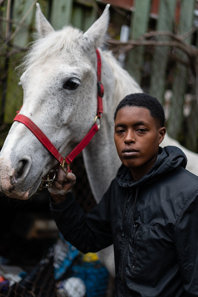 Daeshawna Chaney poses for a portrait between cleaning stalls at the Carlton Street Stable in Baltimore, Md. on May 12, 2020.