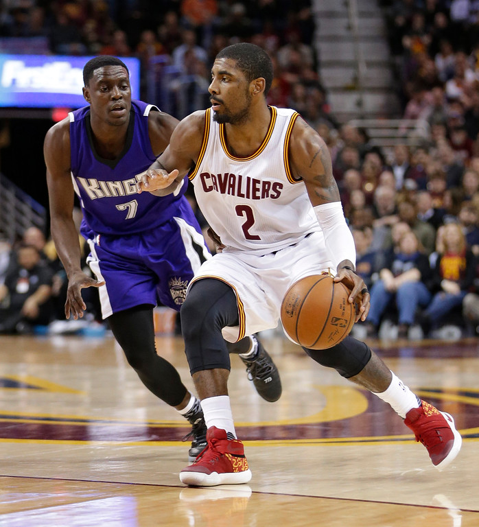 . Cleveland Cavaliers\' Kyrie Irving (2) drives past Sacramento Kings\' Darren Collison (7) in the first half of an NBA basketball game Monday, Feb. 8, 2016, in Cleveland. The Cavaliers won 120-100. (AP Photo/Tony Dejak)