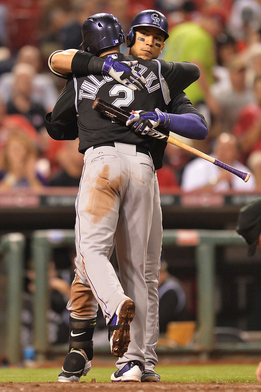 . CINCINNATI, OH - MAY 10: Troy Tulowitzki #2 of the Colorado Rockies is congratulated by Carlos Gonzalez #5 of the Colorado Rockies at home plate after Tulowitzki hit a solo home run in the sixth inning against the Cincinnati Reds at Great American Ball Park on May 10, 2014 in Cincinnati, Ohio. Colorado defeated Cincinnati 11-2. (Photo by Jamie Sabau/Getty Images)