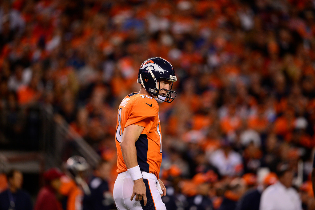 . DENVER, CO - SEPTEMBER 23: Denver Broncos quarterback Peyton Manning (18) during the first quarter. The Denver Broncos took on the Oakland Raiders at Sports Authority Field at Mile High in Denver on September 23, 2013. (Photo by AAron Ontiveroz/The Denver Post)